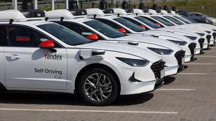 Self-driving Hyundai Motor Co. Sonata automobiles, operated by Yandex.NV, sit parked at the Yandex engineering center in Moscow, Russia, on Wednesday, June 10, 2020.